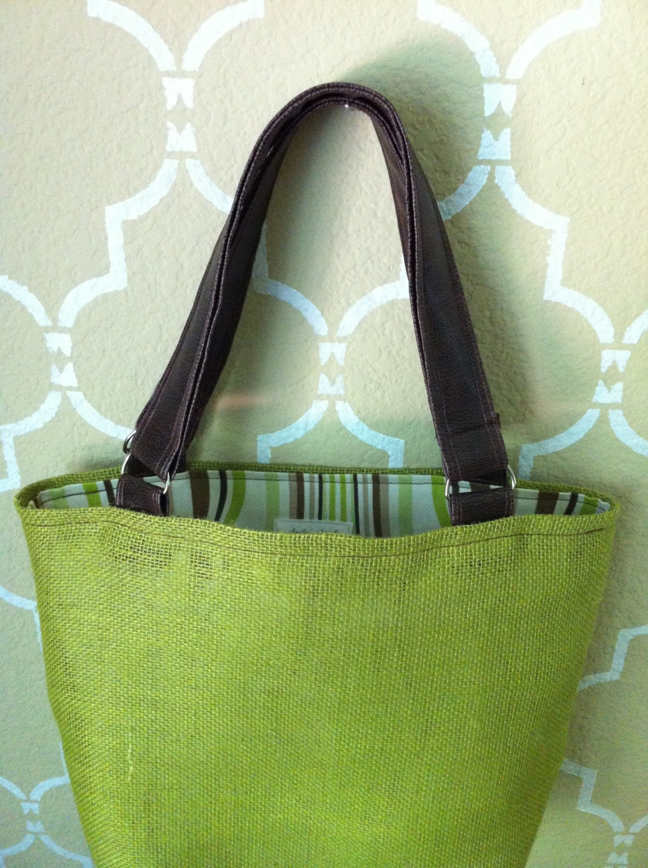 green burlap tote with faux leather straps