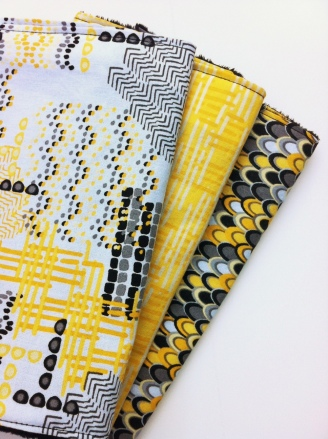 yellow burp cloths
