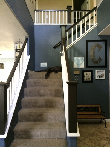 entry way with black stairs